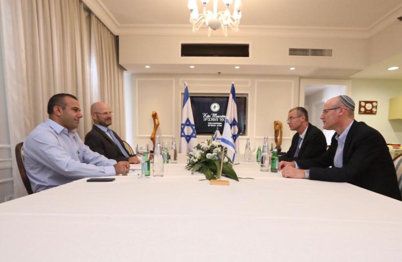 Likud and Blue and White negotiation teams (photo credit: ELAD MALKA)