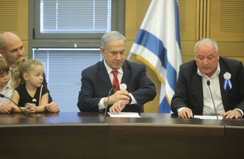 Prime Minister Benjamin Netanyahu is right on time at the opening of the 22nd Knesset on October 3 (photo credit: MARC ISRAEL SELLEM)