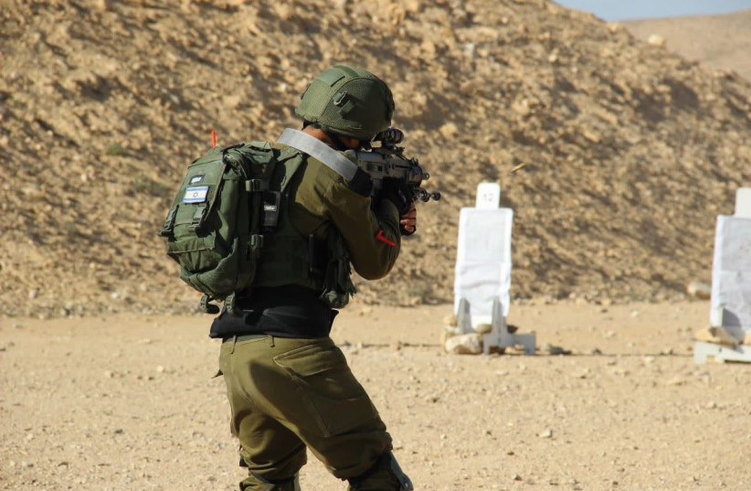 """""""A"""" in his uniform during shooting practice in the IDF (photo credit: IDF SPOKESPERSON'S UNIT)"""