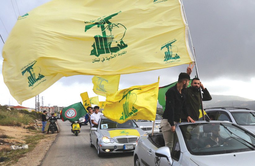 Iran's proxies, including Hezbollah, are empowered throughout the Middle East  (photo credit: REUTERS)