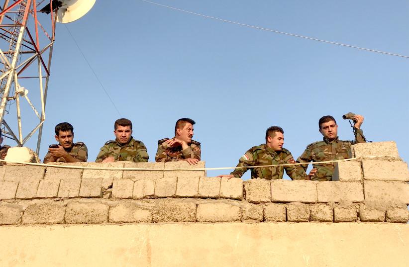 KURDISH PESHMERGA troops overlooking ISIS-held territory in September. (photo credit: SETH J. FRANTZMAN)