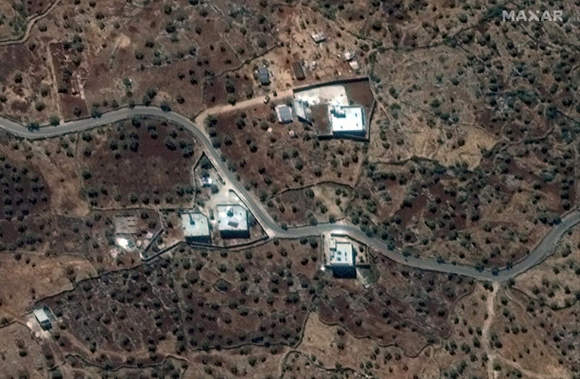 A satellite view of the reported residence of ISIS leader, Abu Bakr al-Baghdadi, according to the source, near the village of Barisha, Syria (photo credit: REUTERS)