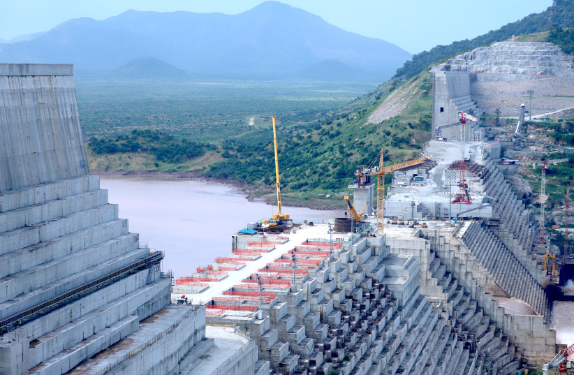 ETHIOPIA'S GRAND Renaissance Dam undergoes construction work on the Nile River in Benishangul Gumuz Region, Ethiopia, on  September 26.  (Tiksa Negeri/File Photo/Reuters) (photo credit: TIKSA NEGERI / REUTERS)