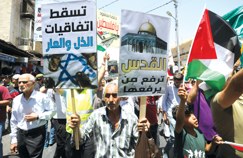 PROTESTERS IN Amman challenge the US and Israel policies on Jerusalem. 'A quick review of the public relationship between Israel and Jordan in the last decade reveals multiple crises,' notes the author.  (photo credit: REUTERS)