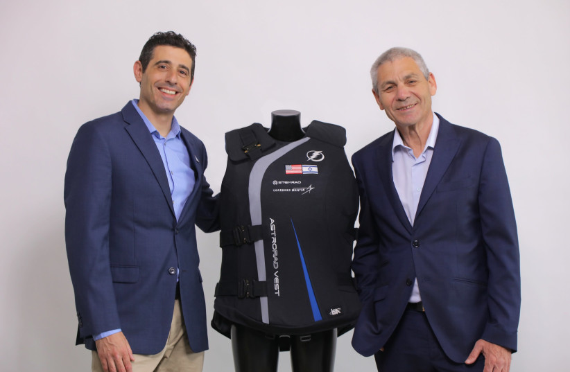 StemRad CEO Dr. Oren Milstein (L) and Israel Space Agency director-general Avi Blasberger with the AstroRad radiation protection vest (photo credit: STEMRAD)