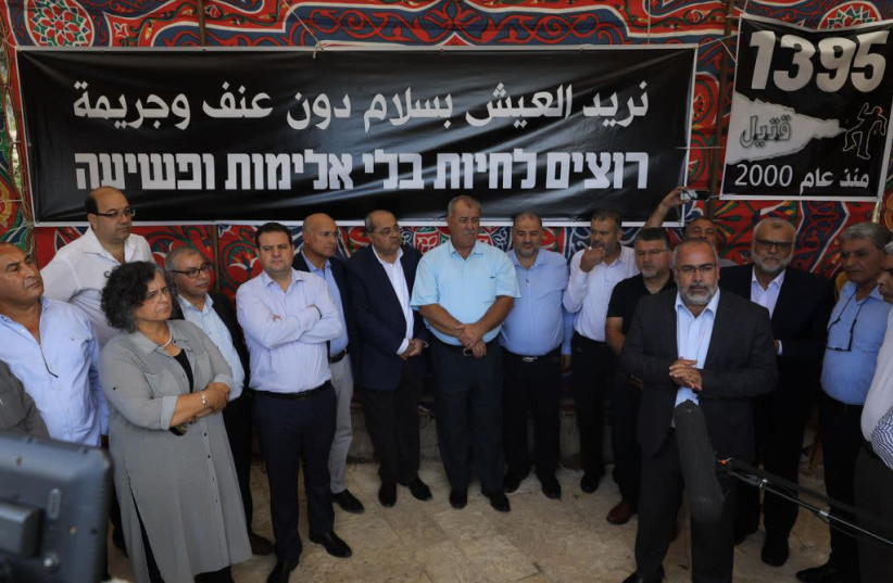 "Arab leaders stand in front of a sign that reads ""We want to live without violence and crime"" (photo credit: MARC ISRAEL SELLEM)"