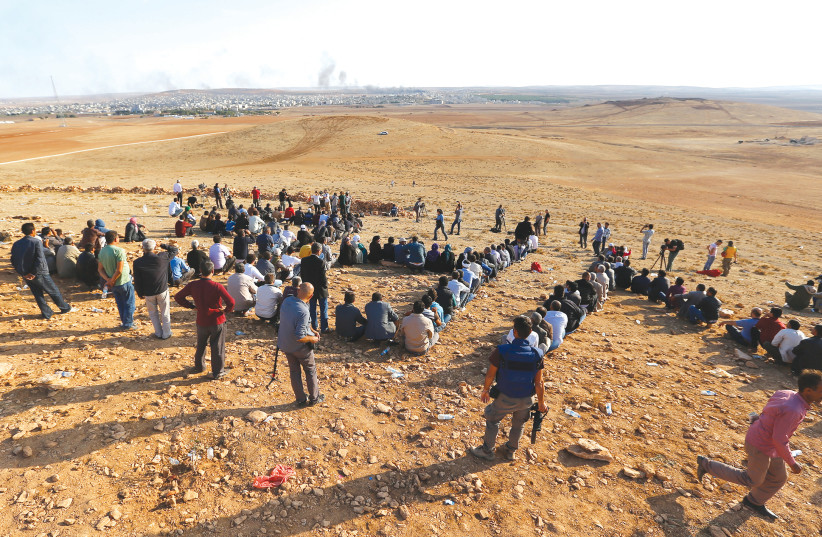 KURDS IN Syria flee the Turkish and Syrian rebel offensive against their formerly peaceful towns last month (photo credit: REUTERS)