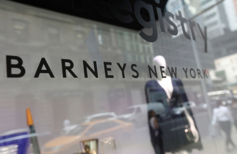 Barneys New York sign is seen in a display window outside the luxury department store (photo credit: SHANNON STAPLETON/ REUTERS)