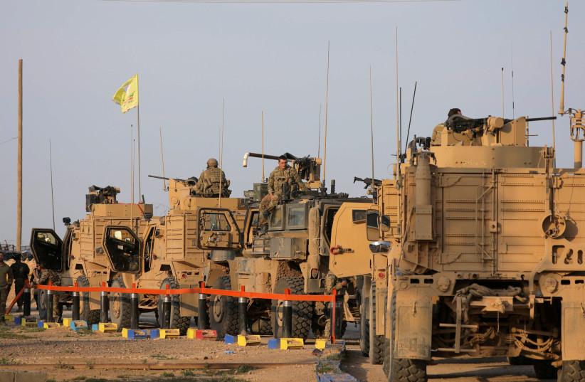 American soldiers stand near military trucks, at al-Omar oil field in Deir Al Zor (photo credit: REUTERS/RODI SAID)