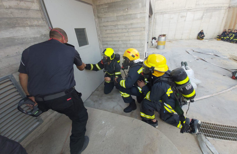 Israeli and Palestinian firefighters practice saving lives together (photo credit: COGAT)