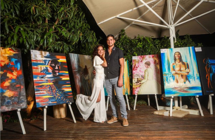 THEN AND now: Tzachi and Tamar Zeitlin. The couple makes a living via lectures and Tamar's paintings (photo credit: SHLOMI YOSEF)