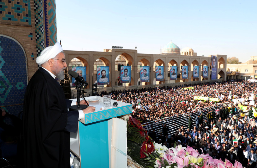 Iranian President Hassan Rouhani addresses the crowd of people in Yazd, Iran (photo credit: REUTERS)
