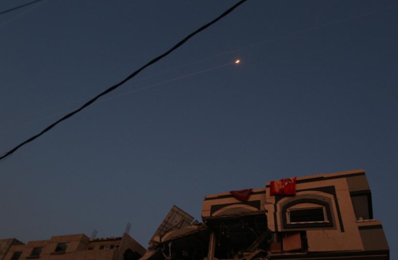 Rockets fly over the house where Palestinian Islamic Jihad leader Bahaa Abu Al-Ata was assassinated by the IDF (photo credit: MAJDI FATHI/TPS)