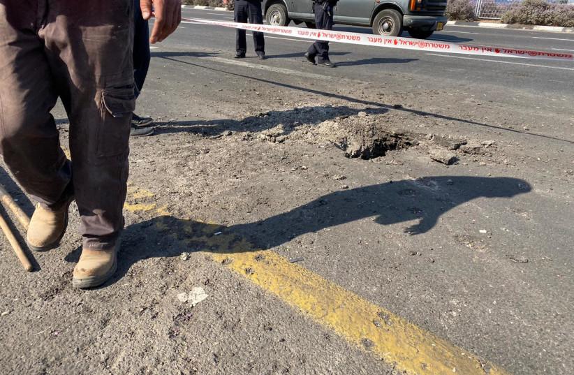 Rocket from Gaza lands on a road in Gan Yavne (photo credit: SETH J. FRANTZMAN)
