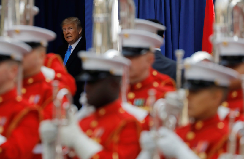 U.S. President Donald Trump arrives for a Veterans Day Parade and Wreath Laying ceremony in Manhattan, New York City, U.S., November 11, 2019 (photo credit: ANDREW KELLY / REUTERS)