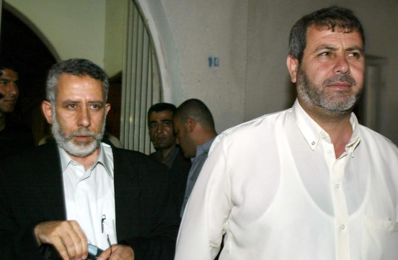 TOP ISLAMIC JIHAD OFFICIAL MOHAMMED AL-HINDI AND KHALED AL-BATSH LEAVE AFTER MEETING IN GAZA. (photo credit: REUTERS)