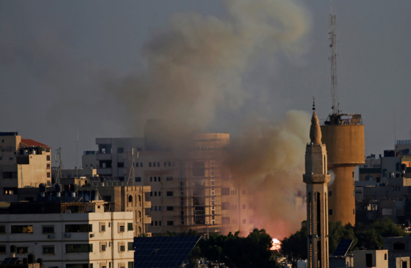 Flame and smoke are seen following an explosion in Gaza City November 12, 2019 (photo credit: REUTERS/MOHAMMED SALEM)