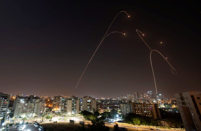 Iron Dome anti-missile system fires interception missiles as rockets are launched from Gaza towards Israel (photo credit: AMIR COHEN/REUTERS)