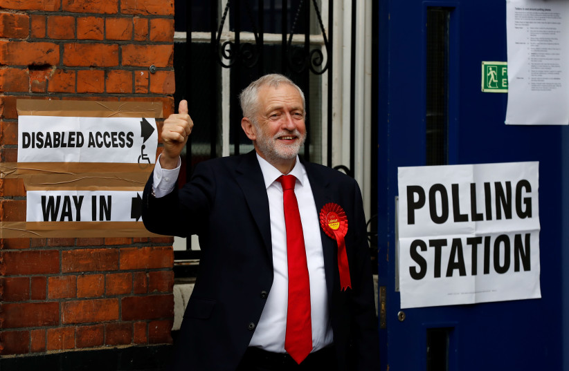 Jeremy Corbyn, leader of Britain's opposition Labour Party, arrives to vote in Islington, London, Britain June 8, 2017 (photo credit: STEFAN WERMUTH/REUTERS)