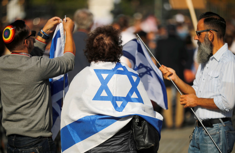 "People attend a demonstration themed with the slogan ""#unteilbar"" (indivisible) to protest against antisemitism, racism and nationalism in Berlin, Germany, October 13, 2019 (photo credit: HANNIBAL HANSCHKE/REUTERS)"