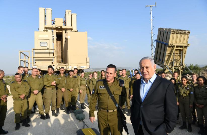 Prime Minister Benjamin Netanyahu [R] visits Iron Dome command   (photo credit: AMOS BEN-GERSHOM/GPO)