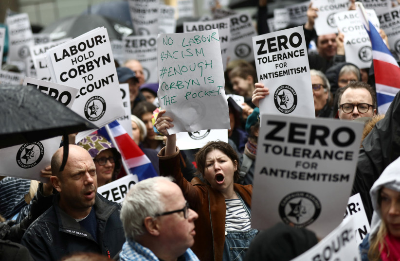 Demonstrators take part in an antisemitism protest outside the Labour Party headquarters in central London, Britain April 8, 2018 (photo credit: SIMON DAWSON/ REUTERS)