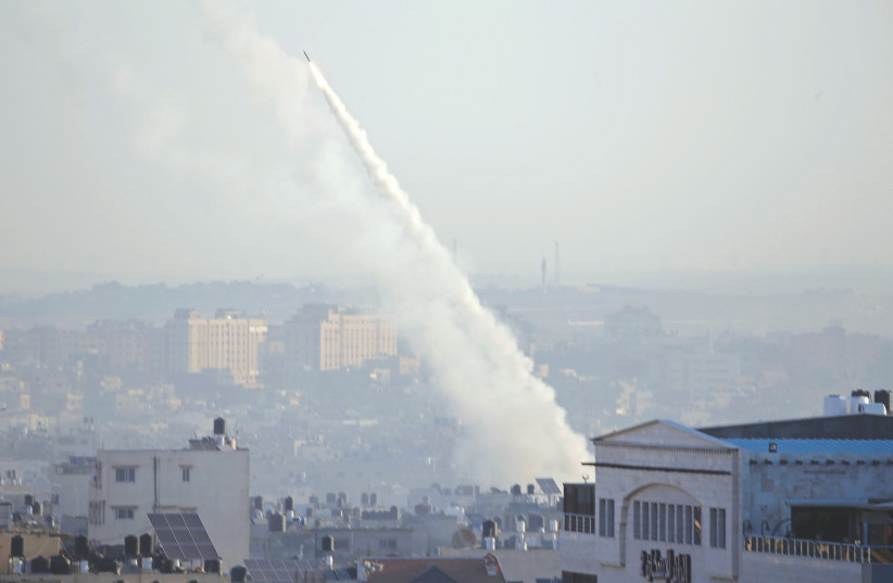 A ROCKET fired from Gaza by the Palestinian Islamic Jihad heads toward Israel this week (photo credit: MOHAMMED SALEM/REUTERS)