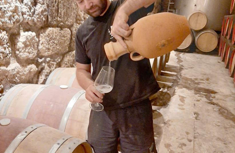 Latroun's winemaker, Adam Kassis, pours his special arak. (photo credit: ADAM MONTEFIORE)