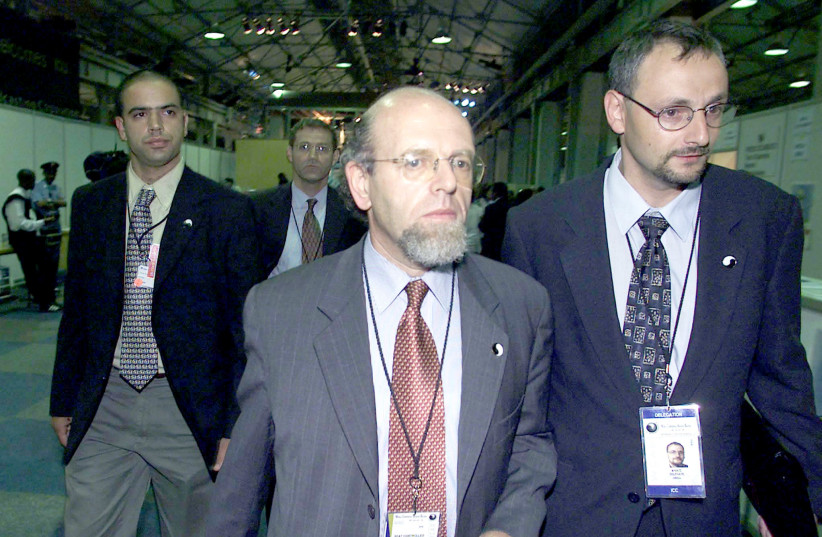 Israeli officials exit the World Conference Against Racism in Durban, 2001, protesting attempts to single out Israel as a racist state.  (photo credit: JUDA NGWENYA / REUTERS)