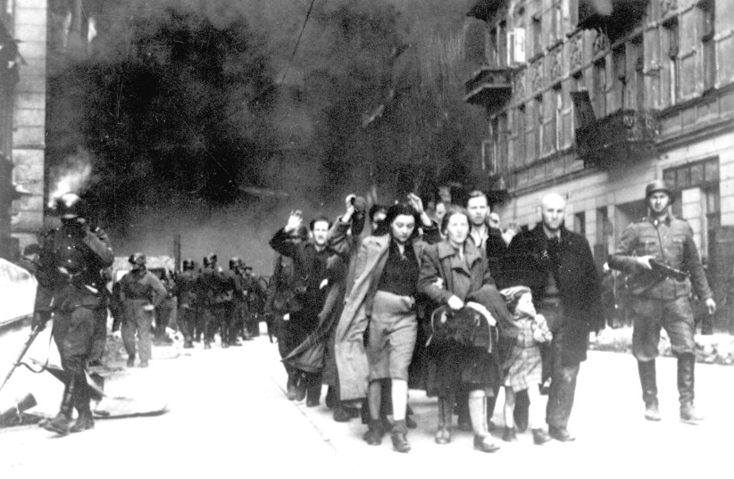 Captured Jews pulled out of Warsaw Ghetto bunkers are led by German Waffen SS soldiers to 'Umschlagplatz,' the assembly point for deportation.  (photo credit: Wikimedia Commons)