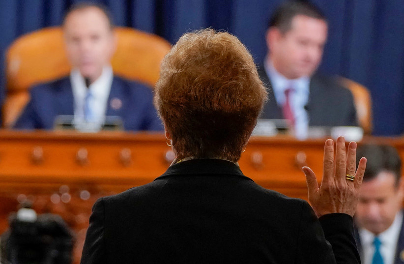 Marie Yovanovitch, former U.S. ambassador to Ukraine, is sworn in before a House Intelligence Committee hearing as part of the impeachment inquiry into U.S. President Donald Trump on Capitol Hill in Washington, U.S., November 15, 2019. (photo credit: JOSHUA ROBERTS/REUTERS/POOL/ABACA PRESS/TNS)