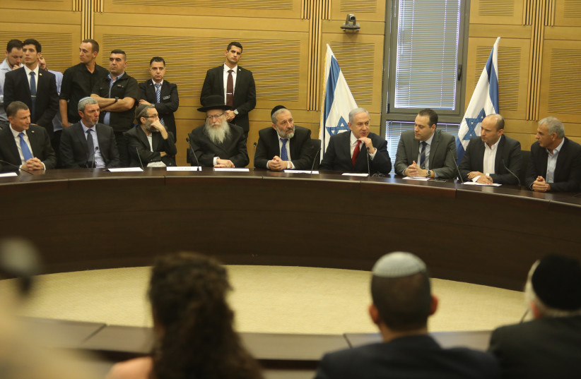 Prime Minister Benjamin Netanyahu at the right-wing bloc faction meeting at the Knesset (photo credit: MARC ISRAEL SELLEM/THE JERUSALEM POST)