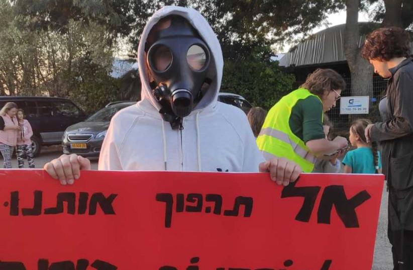 Gas-masked children of Kibbutz Barkai protest local pollution (photo credit: Courtesy)