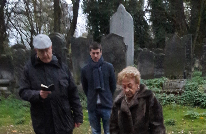 WJRO acting Director General Nachliel Dison recites kaddish by Lax's mother's grave at the Lodz Jewish Cemetery. (photo credit: BARRY DAVIS)