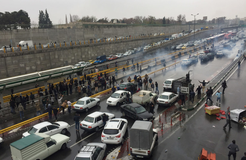 People stop their cars in a highway to show their protest for increased gas price in Tehran, Iran November 16, 2019 (photo credit: REUTERS)