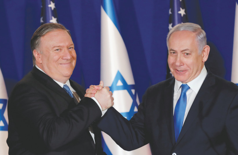 US SECRETARY OF STATE Mike Pompeo shake hands with Prime Minister Benjamin Netanyahu in Jerusalem earlier this year.  Can the US administration be taken seriously when it comes to their interpretation of international law?  (photo credit: JIM YOUNG/REUTERS)