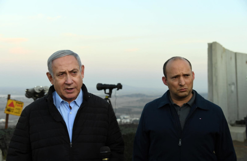 Prime Minister Benjamin Netanyahu and Defense Minister Naftali Bennett tour Mount Avital in the Golan Heights (photo credit: HAIM ZACH/GPO)