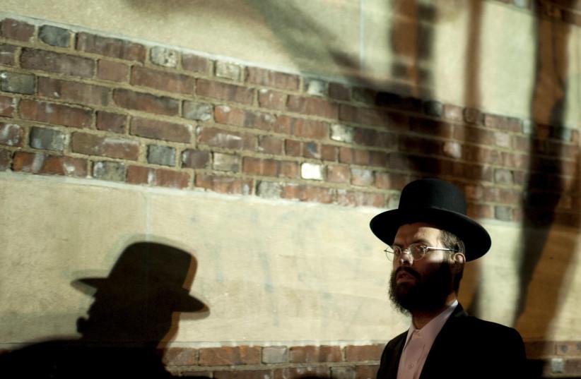 A man arrives at a mass gathering of Satmar Hasidic Jews in the Brooklyn borough of New York December 2, 2015 (photo credit: REUTERS/DARREN ORNITZ)