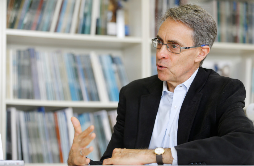 Human Rights Watch Executive Director Kenneth Roth speaks during a interview with Reuters in Geneva, Switzerland, April 9, 2018 (photo credit: REUTERS/PIERRE ALBOUY)