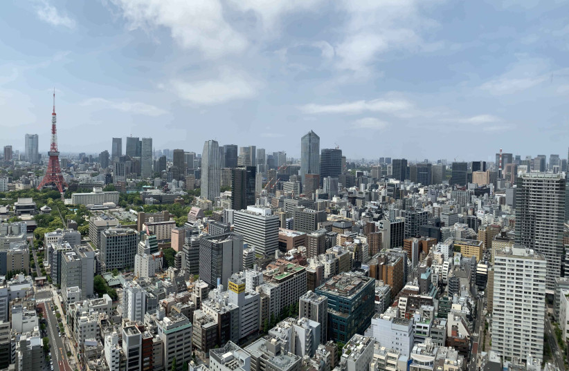 May 13, 2019; Tokyo, JPN; General overall view of the Tokyo Tower in the Shiba-Koen district of Minato and Tokyo downtown skyline. The tower, built in 195, is 1,092 feet (332.9m). The games of the XXXII Olympiad, will be held in Tokyo on July 24-Aug 9, 2020 (photo credit: KIRBY LEE/USA TODAY/VIA REUTERS)