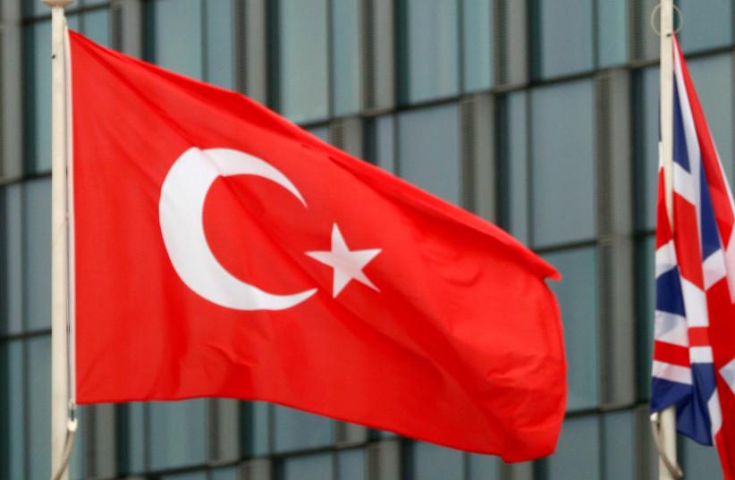 Turkish flag flutters at the Alliance headquarters in Brussels, Belgium, (photo credit: REUTERS/FRANCOIS LENOIR)