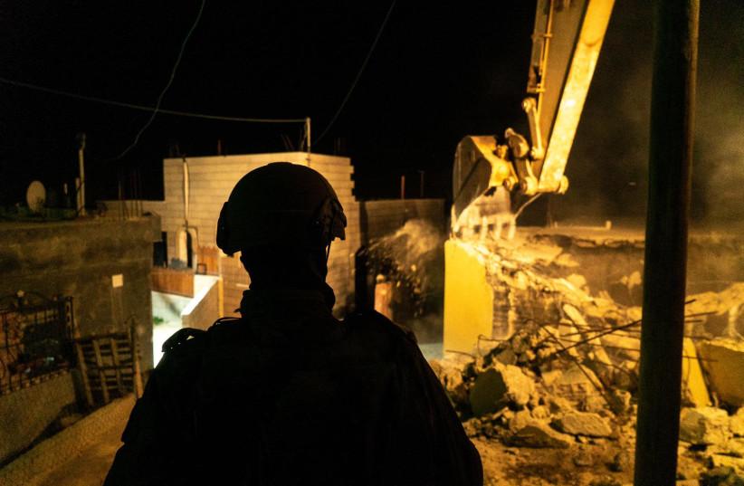 IDF soldiers demolish the houses of the terrorists who killed 18-year-old Dvir Sorek. Nov. 28, 2019 (photo credit: IDF SPOKESMAN'S UNIT)