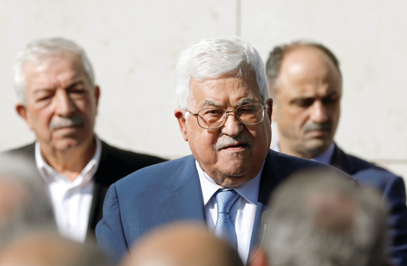 PALESTINIAN PRESIDENT Mahmoud Abbas attends a ceremony marking the 15th anniversary of the death of his predecessor Yasser Arafat, in Ramallah in the Israeli-occupied West Bank.  (photo credit: REUTERS)