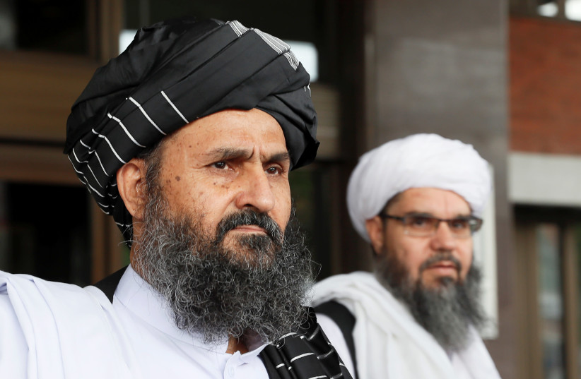 Taliban chief negotiator Mullah Abdul Ghani Baradar (front) leaves after peace talks with Afghan senior politicians in Moscow, Russia May 30, 2019 (photo credit: REUTERS/EVGENIA NOVOZHENINA)