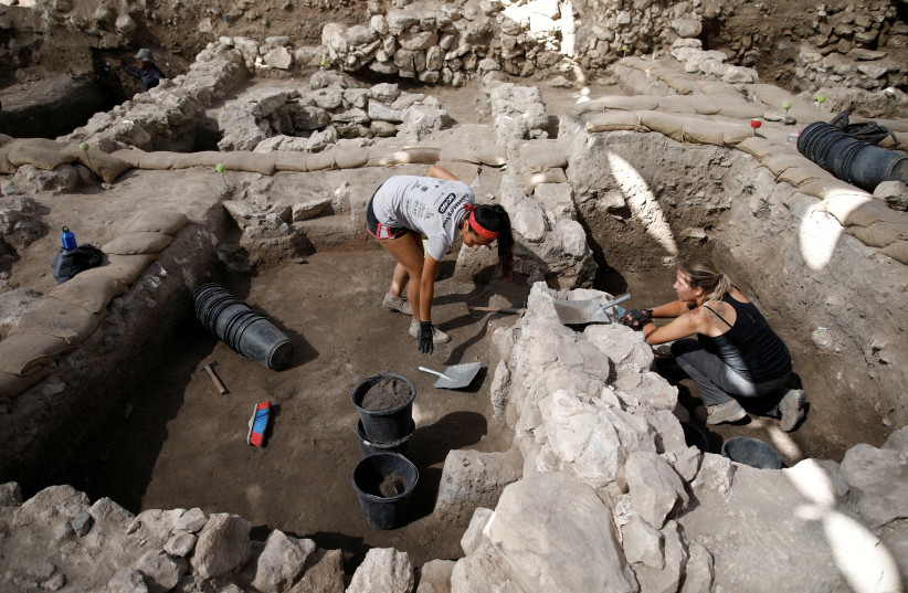 Workers dig at the Tel Megiddo Archaeological site in northern Israel July 24, 2018. (photo credit: AMIR COHEN/REUTERS)