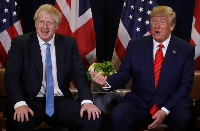 U.S. President Donald Trump holds a bilateral meeting with British Prime Minister Boris Johnson (L) on the sidelines of the annual United Nations General Assembly in New York City, New York, U.S., September 24, 2019 (photo credit: JONATHAN ERNST / REUTERS)