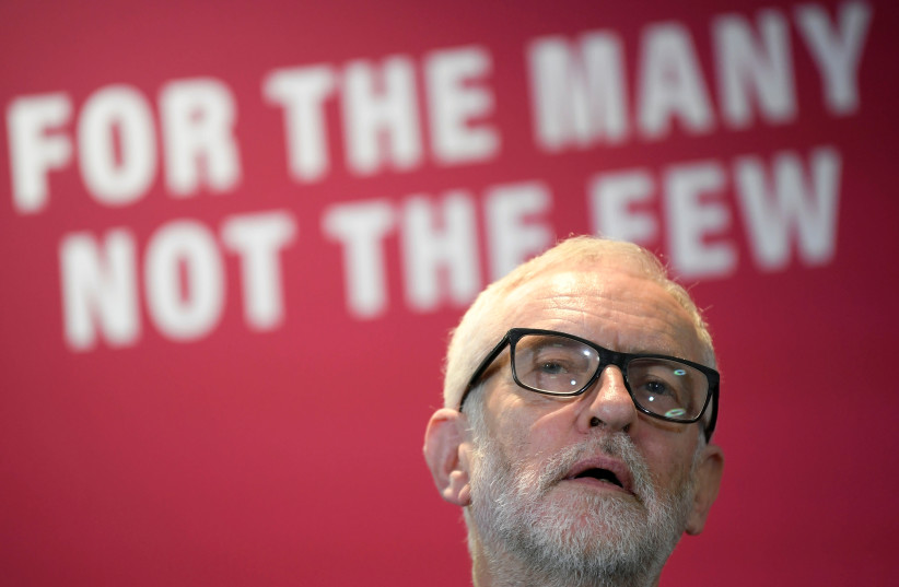 Britain's opposition Labour Party leader Jeremy Corbyn reacts as he speaks about Labour's environment policies in Southampton, Britain November 28, 2019 (photo credit: REUTERS/TOBY MELVILLE)