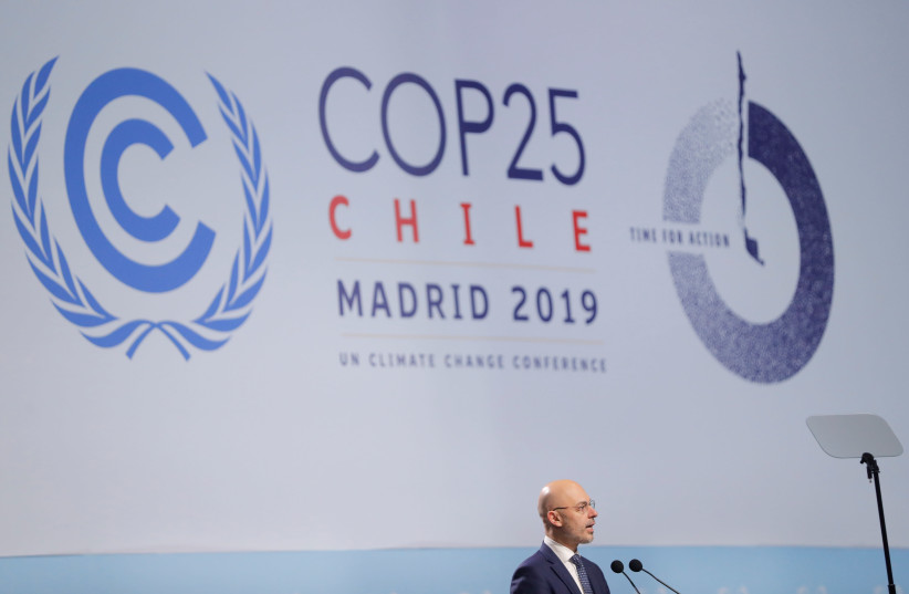 Michal Kurtyka, Poland's Climate Minister and COP24 president, speaks at the opening ceremony of the 2019 U.N. climate change conference (COP25) in Madrid, Spain, December 2, 2019 (photo credit: REUTERS/SUSANA VERA)