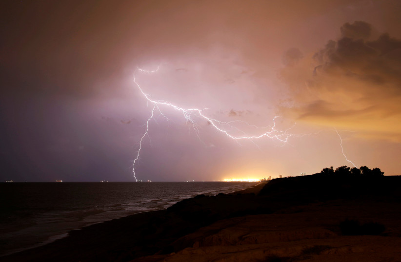 Lightning strikes over the Mediterranean sea during a rain storm near the city of Ashkelon (photo credit: AMIR COHEN/REUTERS)