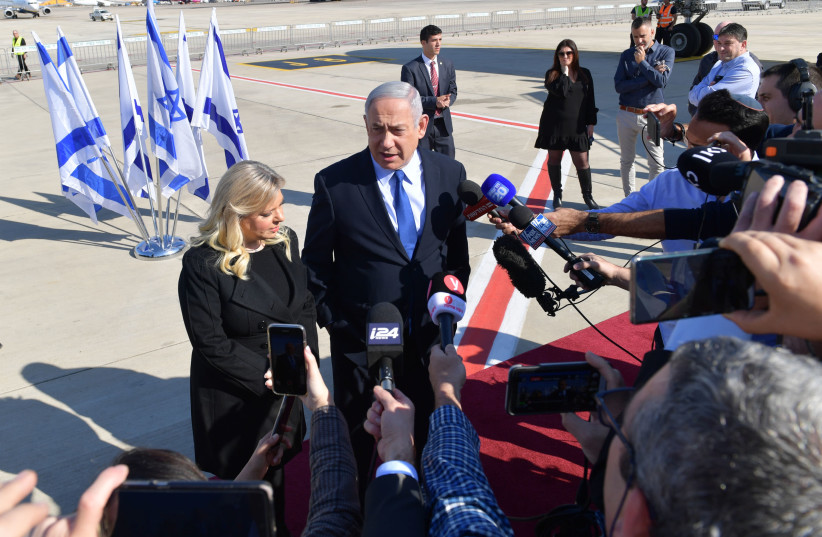Prime Minister Benjamin Netanyahu and his wife Sara speak to the press before boarding the plane to Lisbon (photo credit: KOBI GIDEON/GPO)